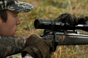 man sighting in swarovski scope