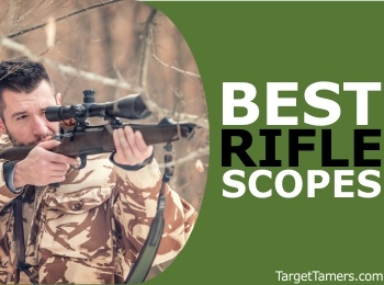 Male Hunter Looking Through Scope on Firearm