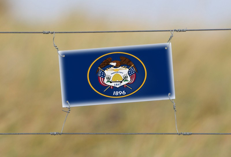 border-fence-old-plastic-sign-with-a-flag-of-utah