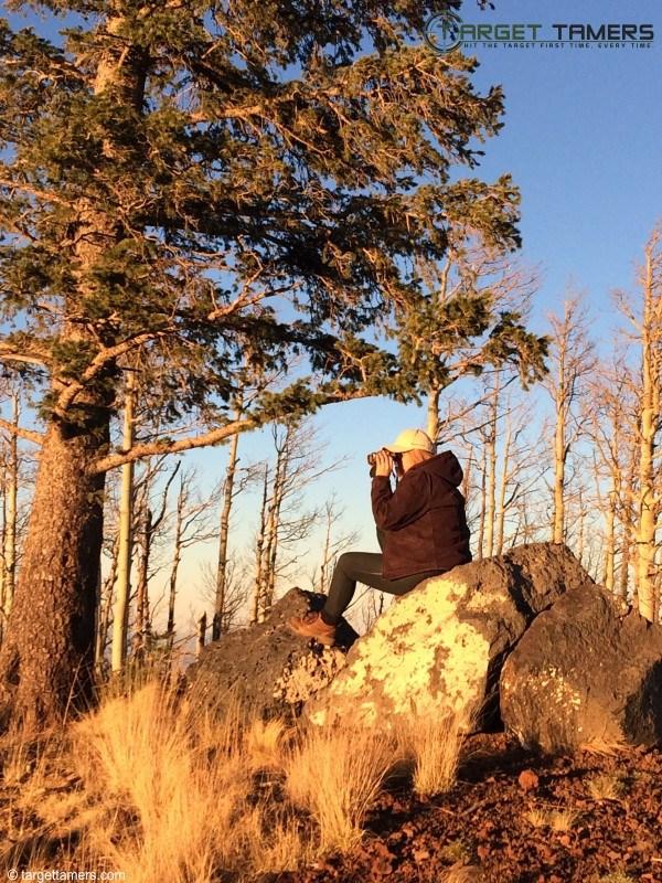 Looking through a pair of binoculars.