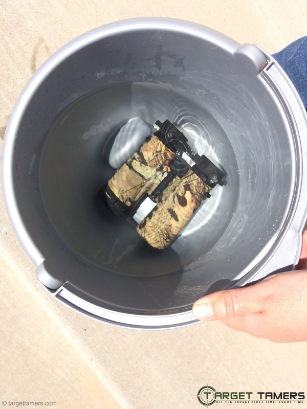 Carson 10x42 binoculars in a bucket of water to check waterproof ability