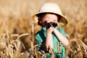 Child Using a Monocular on Safari