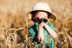 Child Using a Monocular on Safari