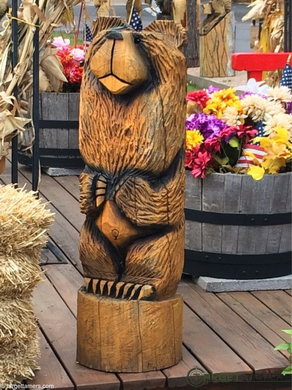 A bear carved out of wood
