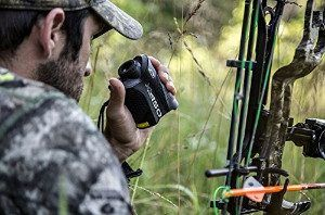 Bow hunter holding XL450 Rangefinder