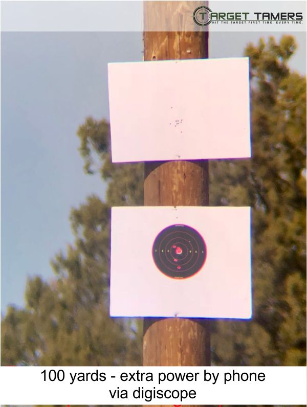 Photo of bullet groupings at 100 yards taken through Carson spotter at 45x with extra power via phone