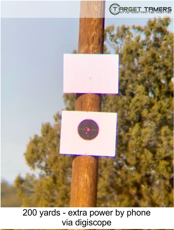 Photo of bullet groupings at 200 yards taken through Carson spotter at 45x with extra power via phone and digiscope
