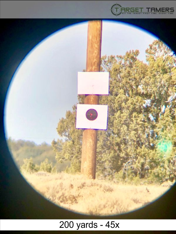 Photo of bullet groupings at 200 yards taken through Carson spotter at 45x