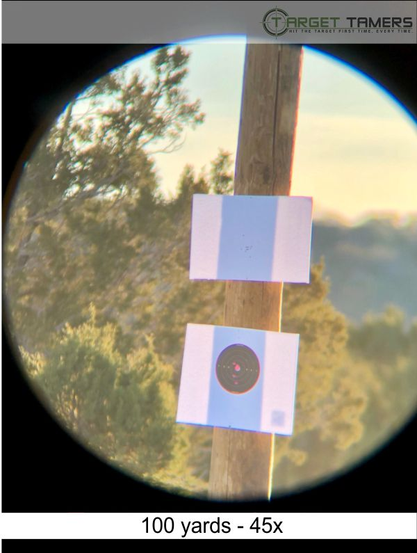 Photo of bullet groupings at 100 yards taken through Everglade spotter at 45x