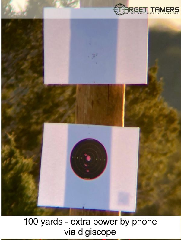 Photo of bullet groupings at 100 yards taken through Everglade spotter at 45x with extra power of phone via digiscope