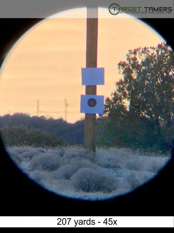 Photo of bullet groupings at 207 yards taken through Everglade spotter at 45x