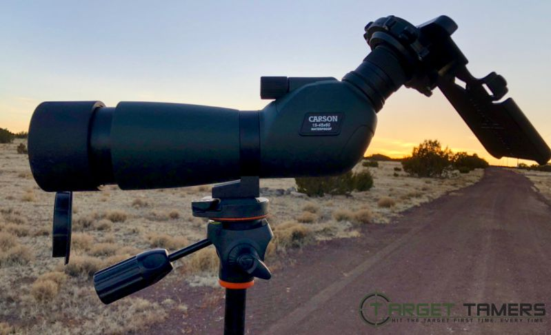 Everglade spotting scope set up on tripod with lens cap flipped down