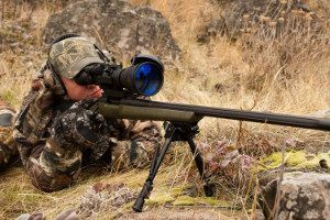 Nemesis Gen 2 6x NV scope mounted on rifle in wilderness