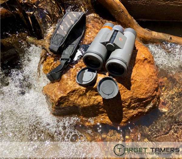 Waterproof Maven binocular sitting on rock in running water