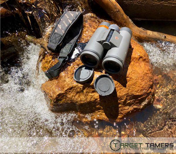 Waterproof Maven binocular sitting on rock in running water