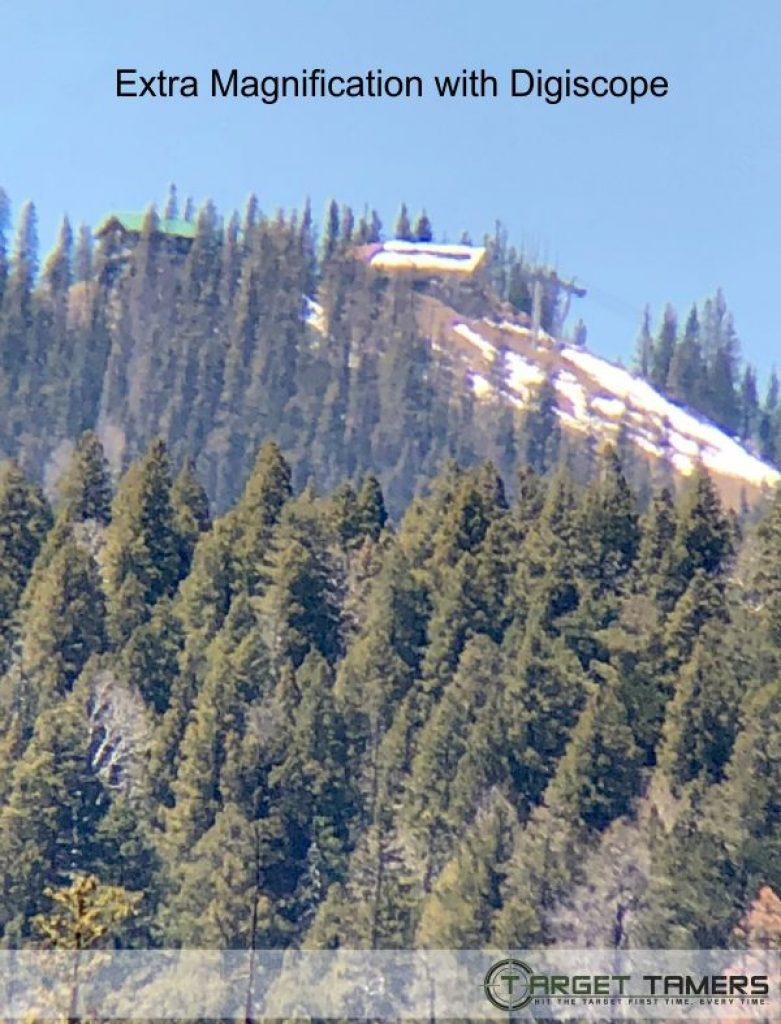 Pic of lodge on mountain top taken with 10x42 bino and extra mag from digiscope