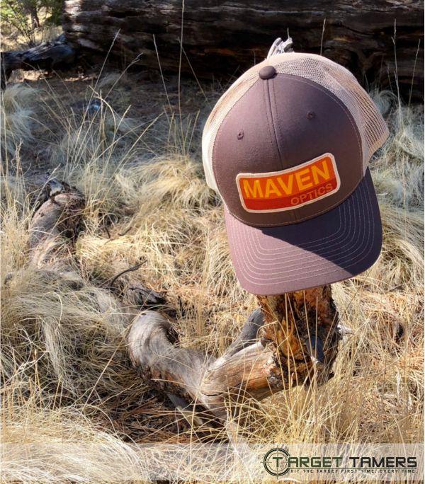 Brown Maven cap hanging on tree branch