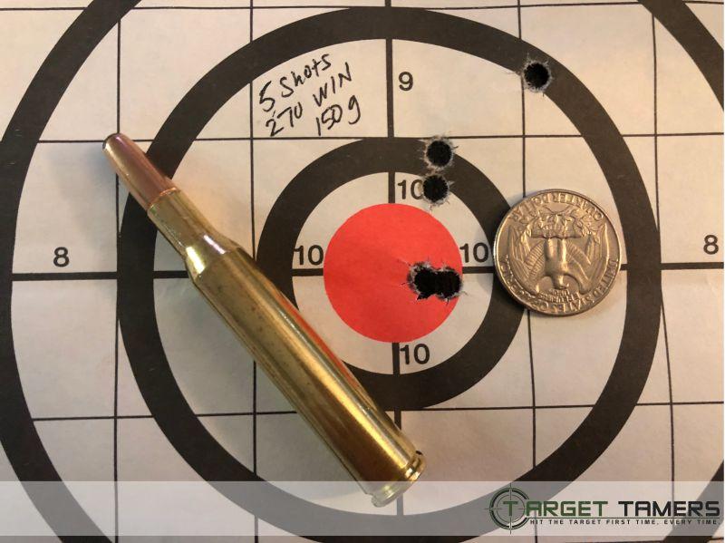 Paper target showing bullet holes & bullet