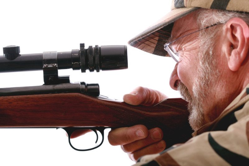 Hunter LookingThrough Rifle Scope