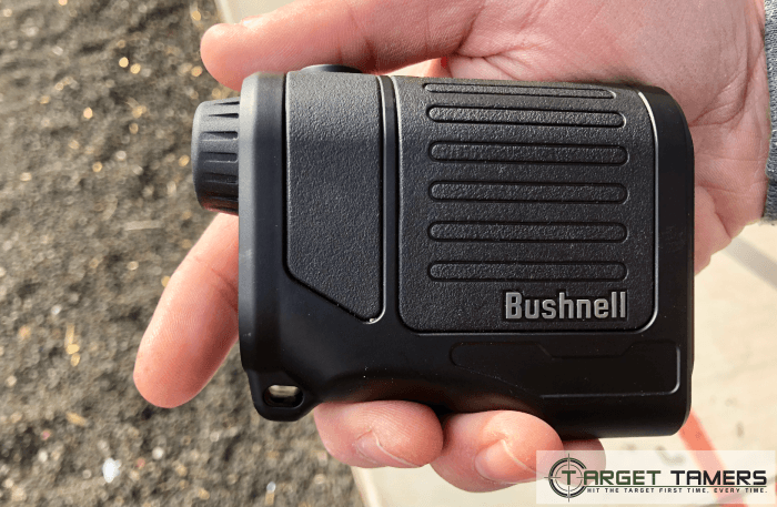 Holding Bushnell Prime Rangefinder in palm of hand