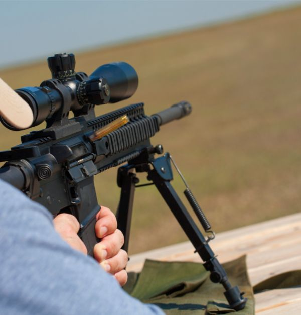 Man Shooting Riflescope With Good AR-15 Optics Mounted