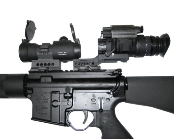 ATN PVS14 3 night vision monocular mounted on rifle