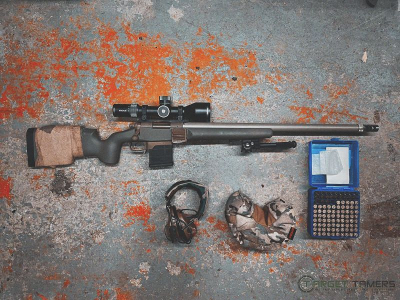 Maven RS.4 5-30x56 riflescope mounted on rifle with safety gear