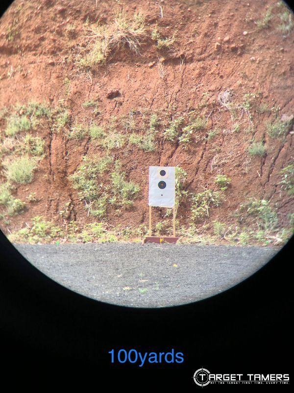 Looking at target on the range at 100 yards through C.3 12x50 binoculars