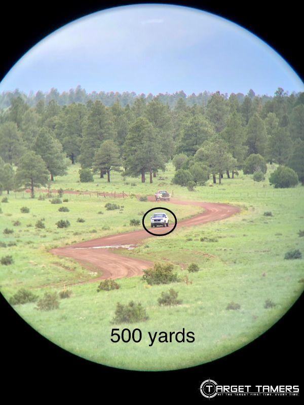 Looking through C.3 12x50 binoculars at truck 500 yards away