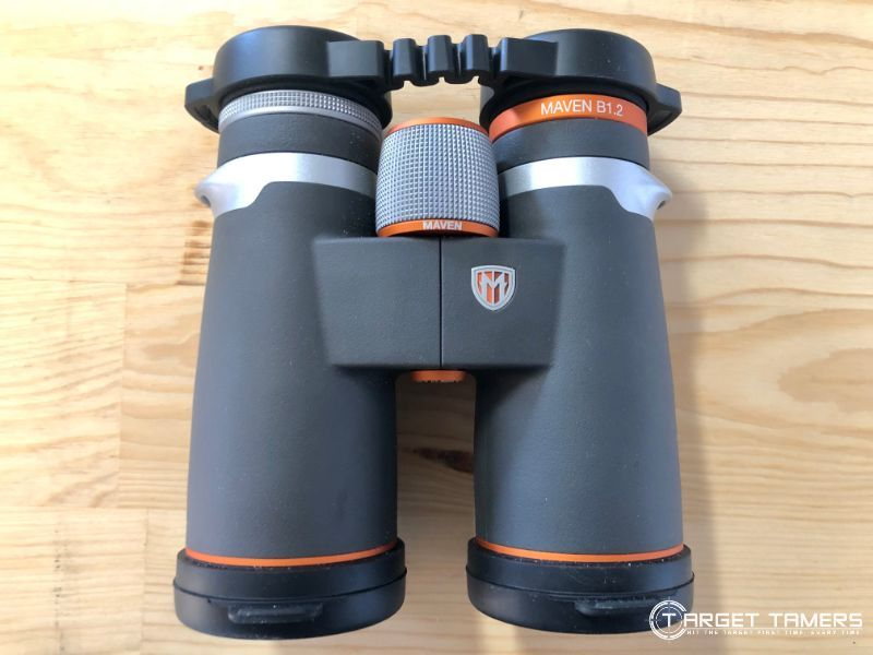 Maven B1.2 10x42 binoculars sitting on table